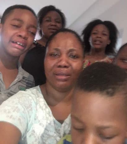 Photo - Rich Kidnapper Evans' Wife & Children Crying