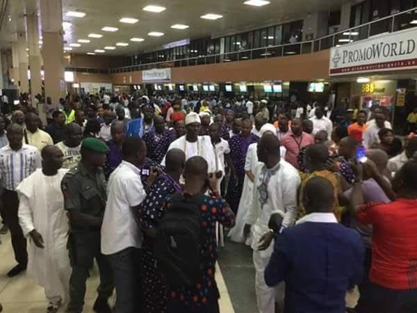 Ooni Of Ife mobbed as he arrives Murtala Muhammed International Airport