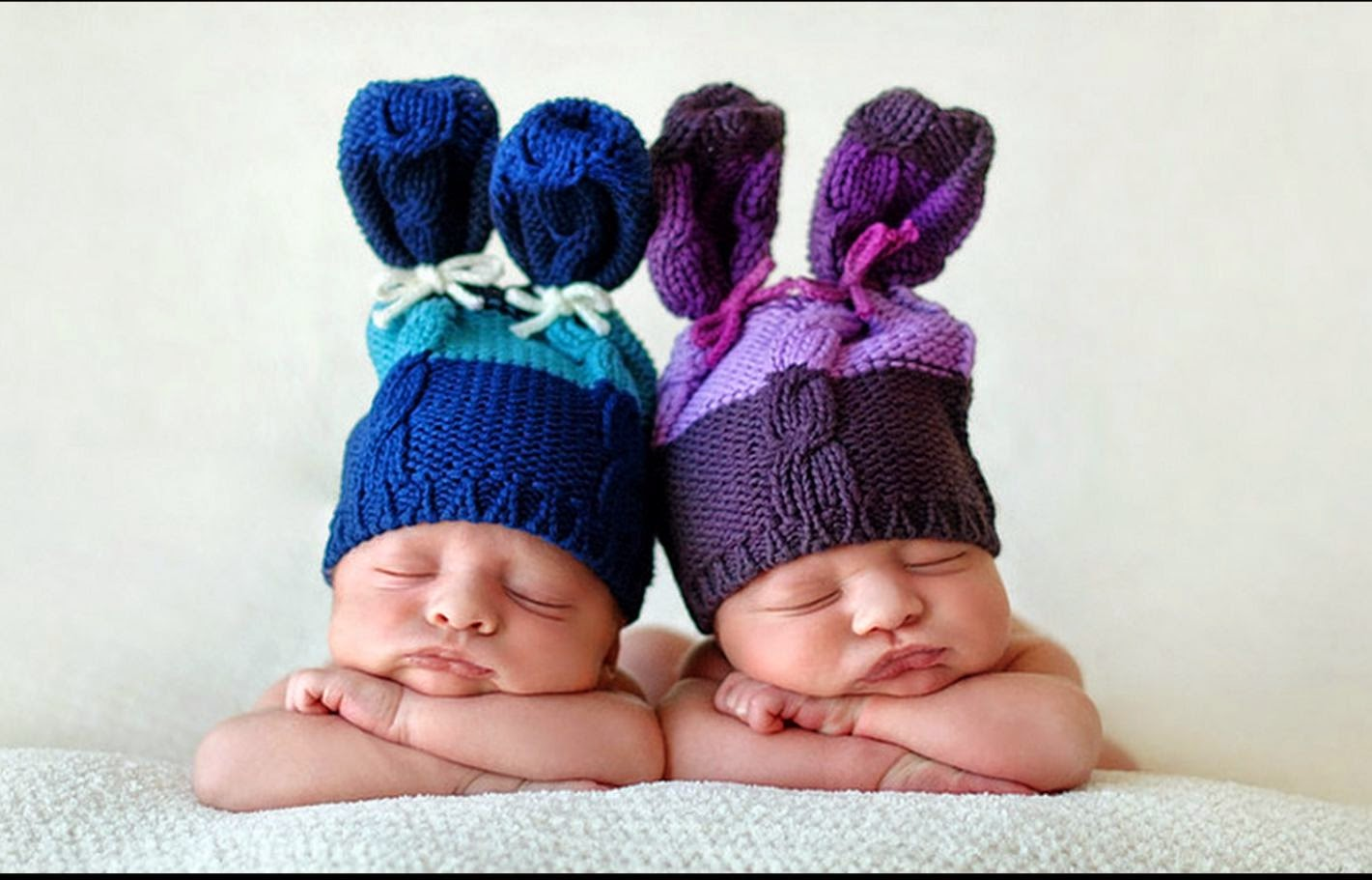 Twin-Babies-cute-sleeping-with-funny-bunny-head.jpg