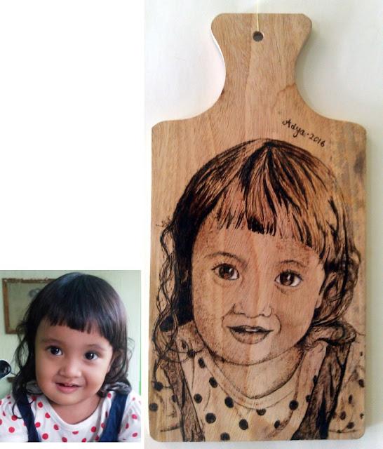 Lukisan wajah pirografi Adya Imoet