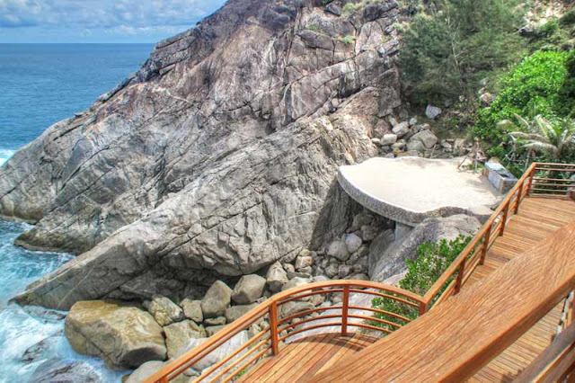Wooden stairs down the cliff