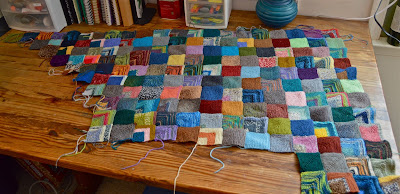 167 out of 252 mitered squares have been knit so far.