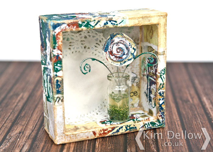 A little single flower in a box mixed media project by Kim Dellow