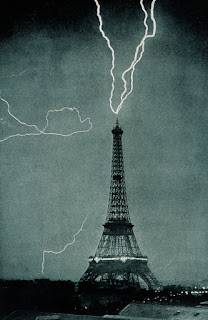 Photo of the Eiffel Tower being struck multiple times by lightning