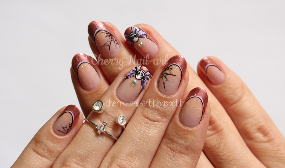 halloween nail art noeud tete de mort sur french manucure