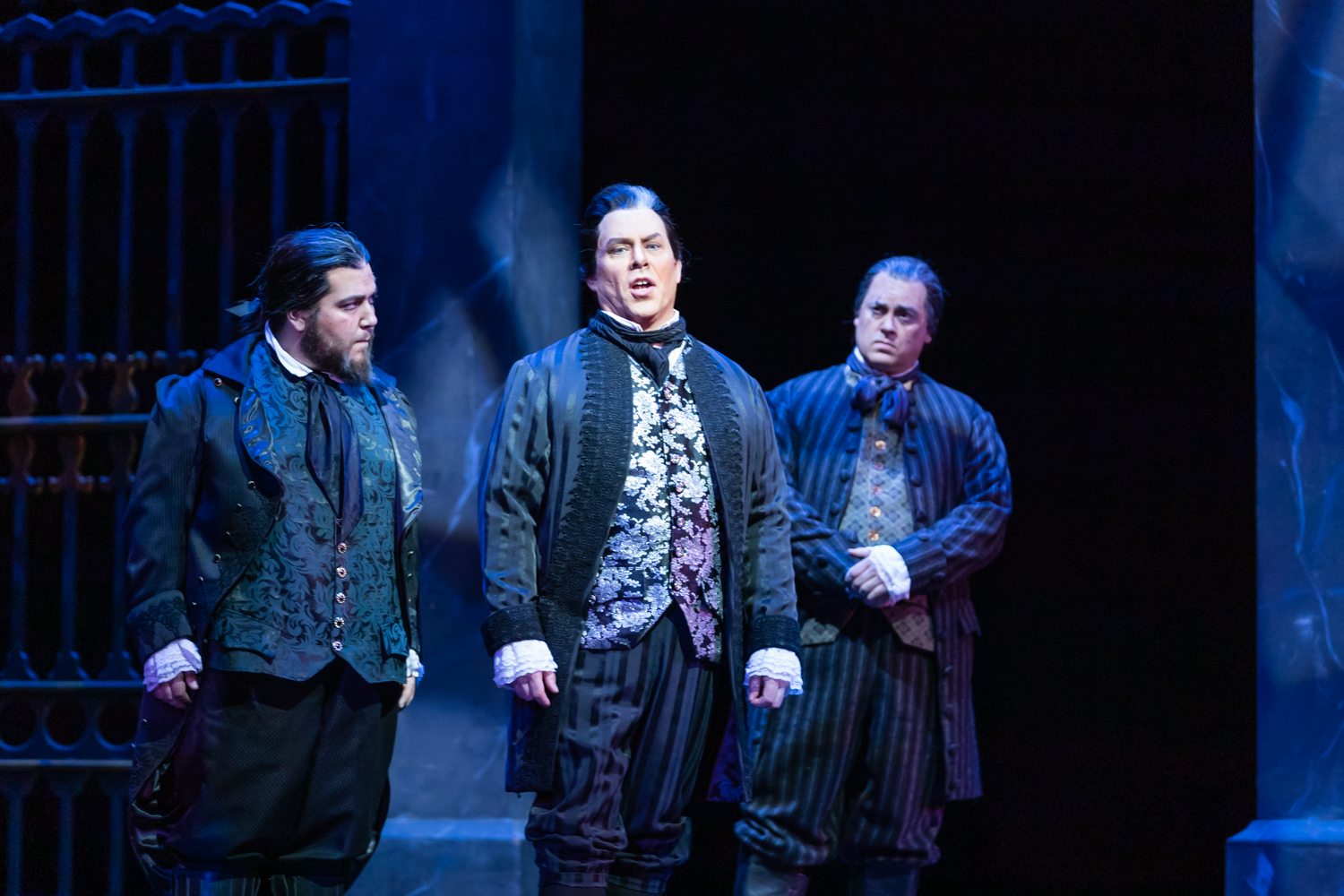 IN REVIEW: (from left to right) tenor JACOB KATO as Spoletta, baritone MALCOLM MACKENZIE as Scarpia, and baritone TED FEDERLE as Sciarrone in North Carolina Opera's April 2019 production of Giacomo Puccini's TOSCA [Photograph by Eric Waters, © by North Carolina Opera]