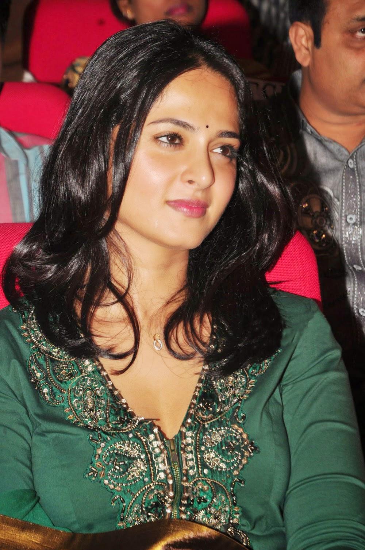 Glamorous Anushka Shetty Smiling Face Photos In Green Dress