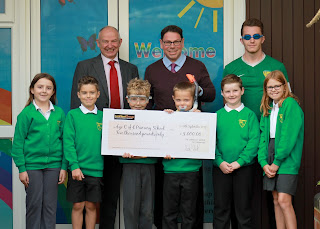 Larkfleet Homes hands over cheque for Eye school swimming pool