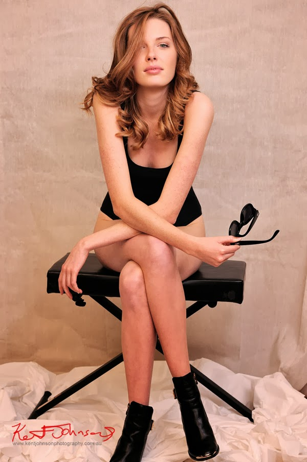 Hayley Wilson in black one-piece swimsuit seated, model portfolio photography by Kent Johnson.