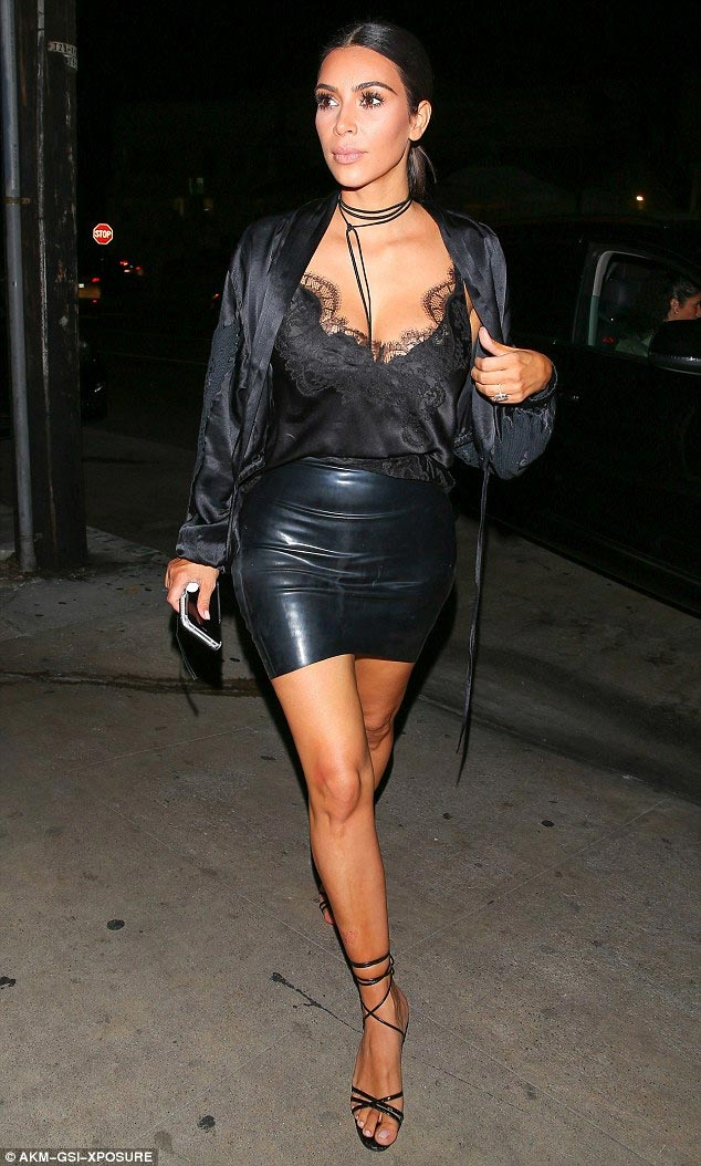 Kim Kardashian steps out in tight leather skirt for date with hubby Kanye West