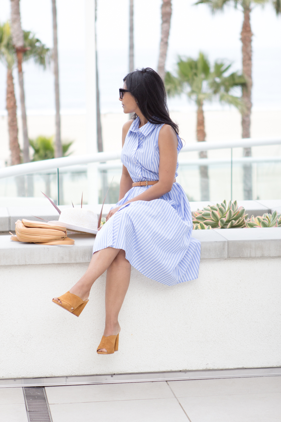 vacation wear, holiday dressing, poolside with cocktails, relaxed dressing, chic dress, belted dress, shirtdress, panama hat, express runway, pearl earrings, stella mccartney, square sunglasses, beach views, palm tree views, mules, mustard slides, vince camuto