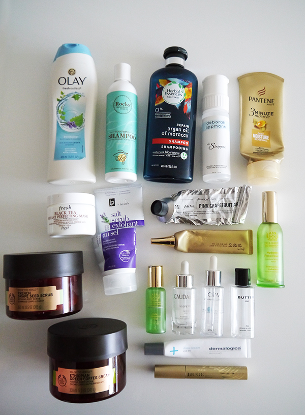 Empty skin and body care products featuring Olay, Herbal Essences, Rocky Mountain Soap Company, Pantene, Deborah Lippmann, BV Spa, Fresh, Leaves of Trees, The Face Shop, Tata Harper, Caudalie, The Body Shop, Butter, Dermalogica, Stila