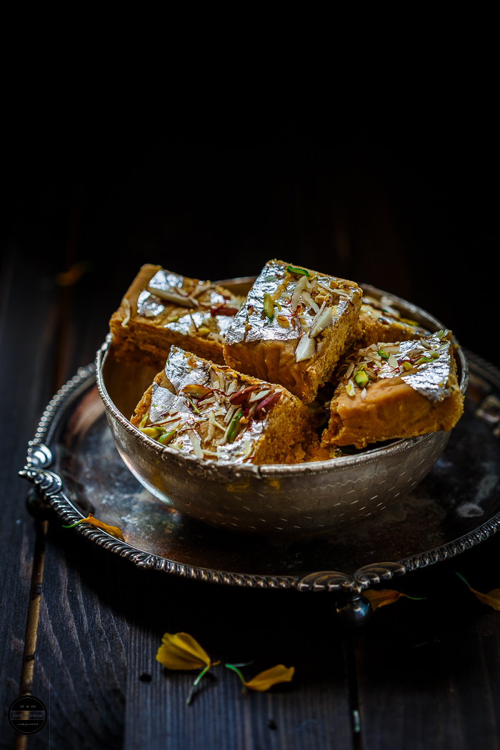 Mohanthaal, A square chickpea flour buttery fudge is a popular Gujarati and Rajasthani sweet. Mostly prepared and served during the festival of Diwali. A melt in mouth, divine sweet prepared with Besan, Ghee, sugar and nuts.