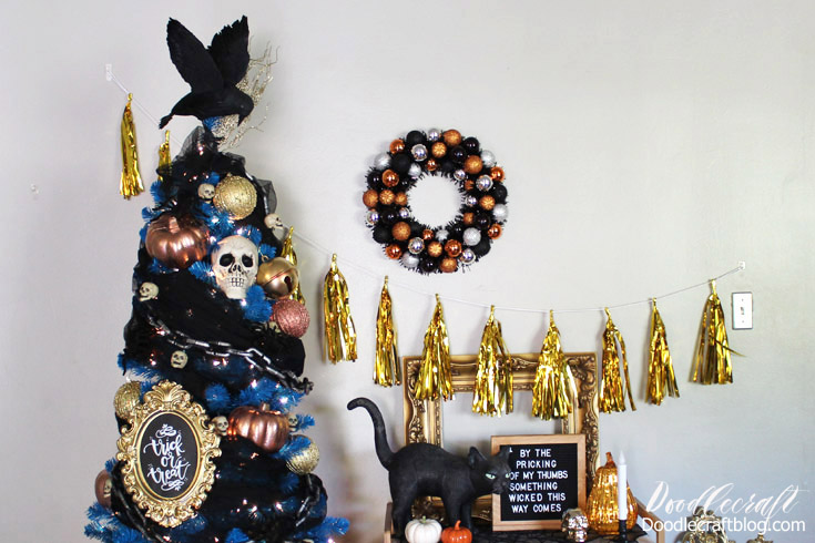 Bright blue decorated Halloween tree full of haunts and spooks!