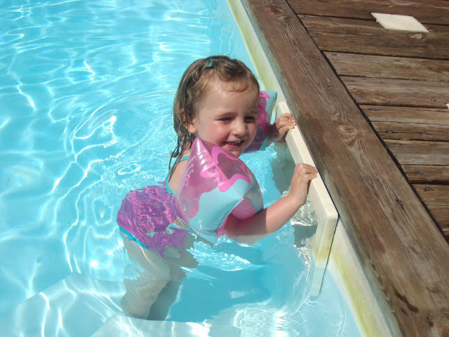 Sasha looking happy in pool aged 2