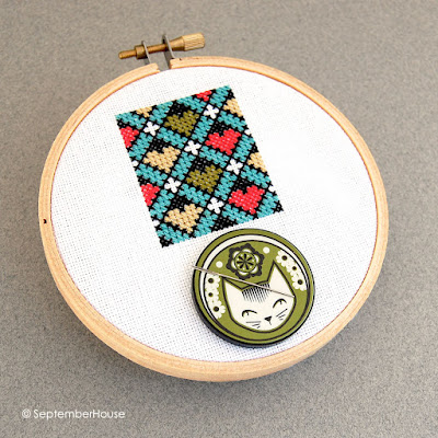 needle minder cross stitch cat