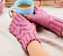 http://www.letsknit.co.uk/free-knitting-patterns/blacker-swan-cabled-wristwarmers