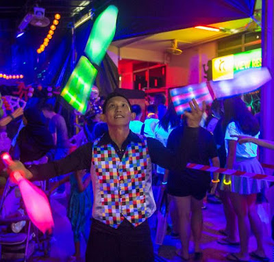 LED Juggler performs LED Juggling