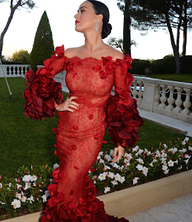 Katy Perry stuns in red ruffle gown at Cannes amFar Cinema Against AIDS gala. See stunning photos at JasonSantoro.com