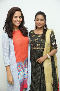 Actress Suma in Black Salwar Suit and Anusuya in orange Dress at winner movie press meet part 1 February 2017 (19).JPG