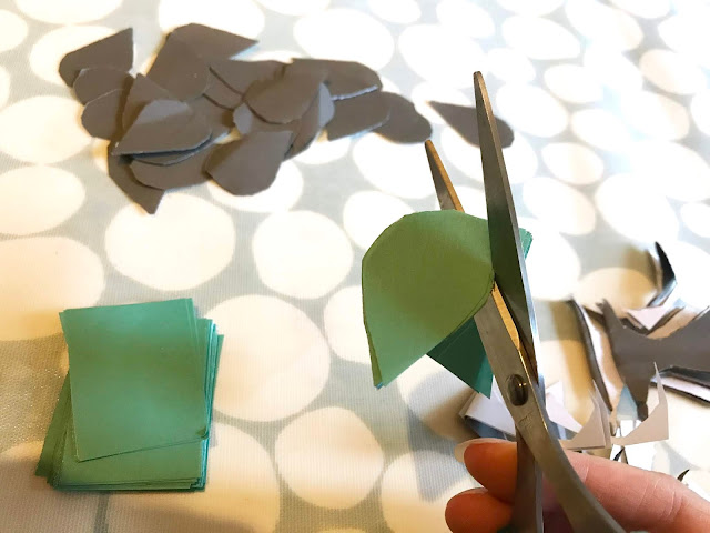 Close up of cutting a raindrop shape out of coloured paper