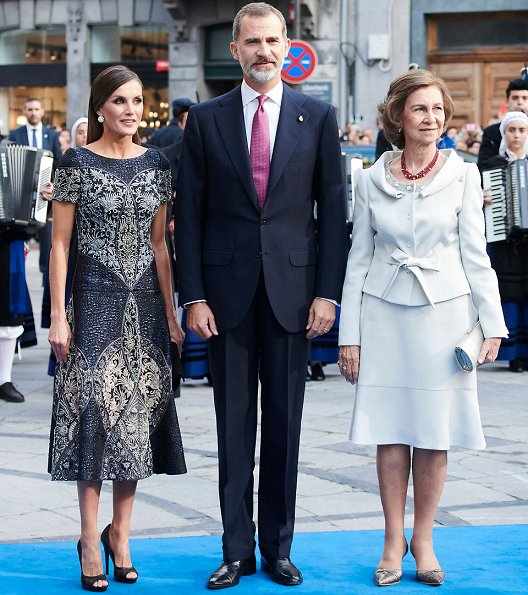 King Felipe and Queen Sofia at Princess of Asturias Awards 2018 ceremony. Queen Letizia wore Felipe Varela dress and Magrit pumps