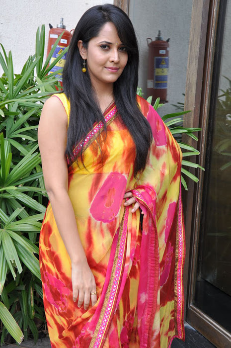 Anchor Anasuya Beautiful Pictures In Yellow Saree