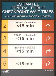 Reader board with estimated security wait times at Sea-Tac Airport