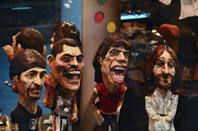 Papier Mache figures of famous musicians in Barcelona shop