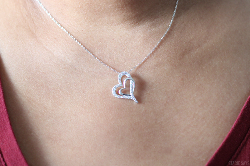 a heart pendant on a black woman's neck