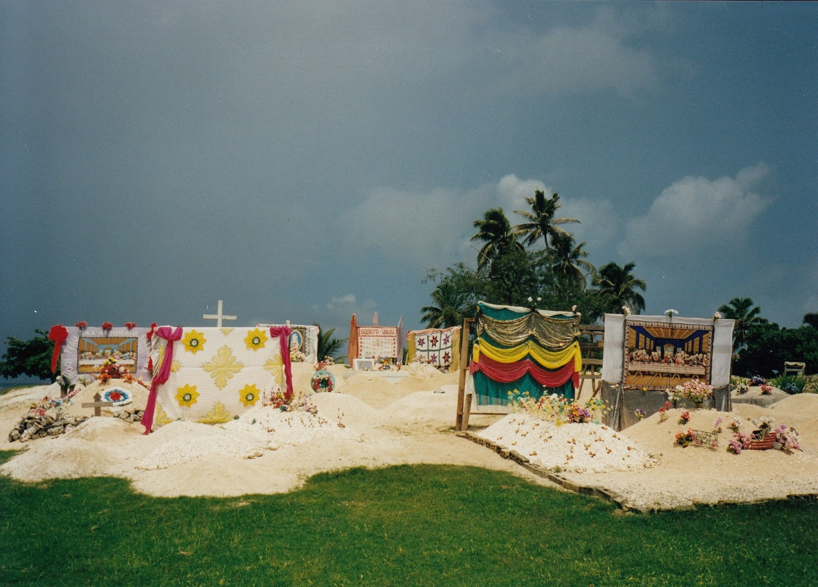 Tonga cemeteries are often bright colourful affairs