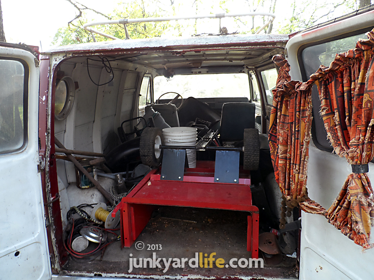 No hut tub or shag carpet inside this 1974 GMC Vandura.