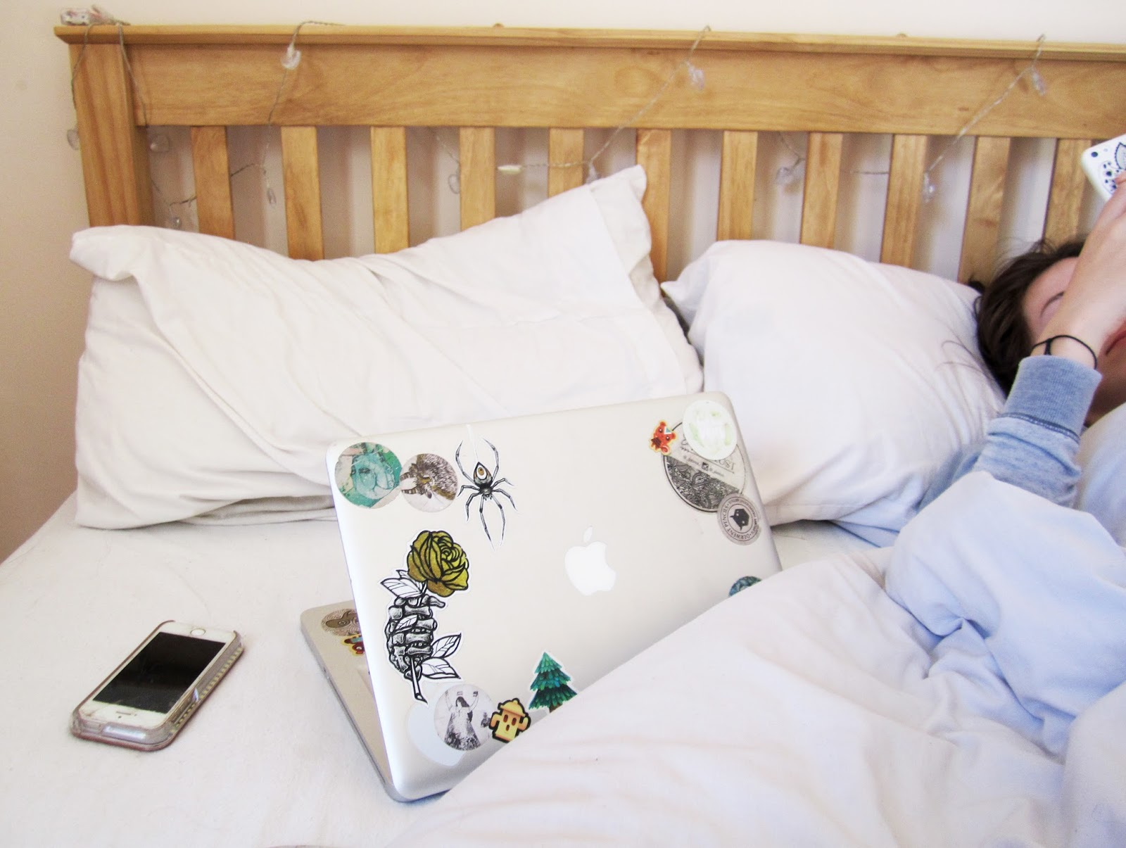 macbook on a bed