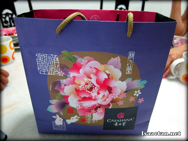 The colourful paper bag housing a box of four Casahana Mooncakes