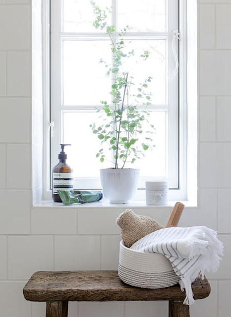 Modern farmhouse white bathroom with rustic wood seat, minimal style, and white subway tile