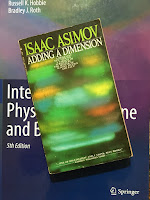 Adding a Dimension, by Isaac Asimov, superimposed on Intermediate Physics for Medicine and Biology.