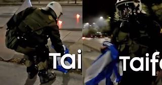 Αστυνομικός έσωσε την ελληνική σημαία από αναρχικούς που ήθελαν να την κάψουν
