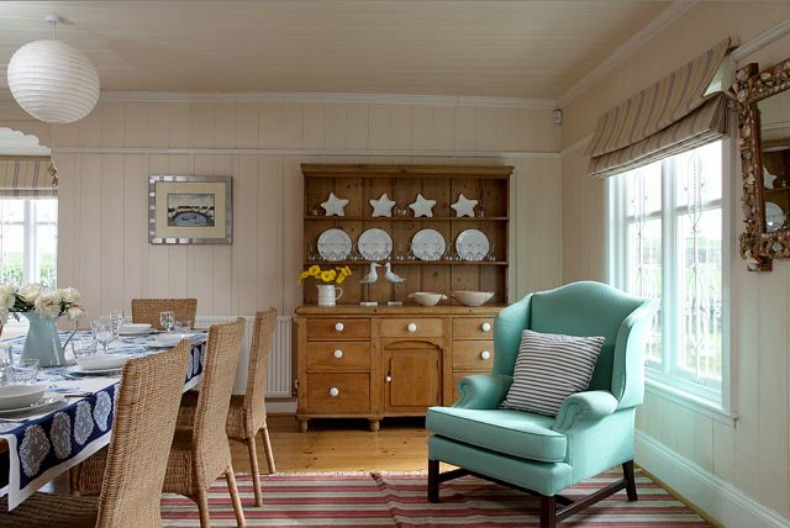 coastal cottage dining room with aqua blue wing chair
