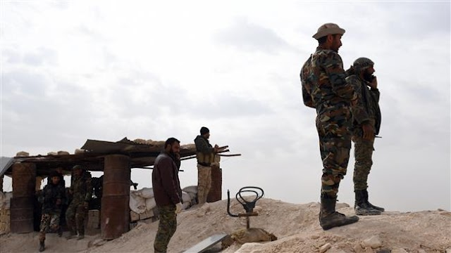 Syrian government army urges surrender of militants encircled near Lebanon border
