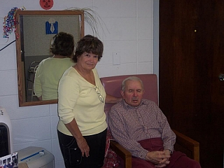 A daughter with his father at a nursing home facility