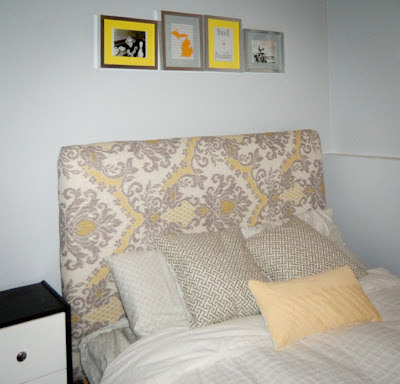 DIY upholstered bed with yellow and grey toile fabric