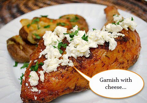 Chicken leg garnished with feta cheese