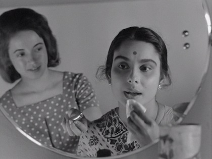 Edith offers lipstick to Arati