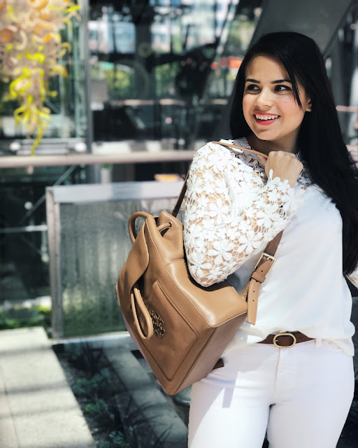 Here are some tricks on how can you make an all white outfit pop and doesn't look too matchy