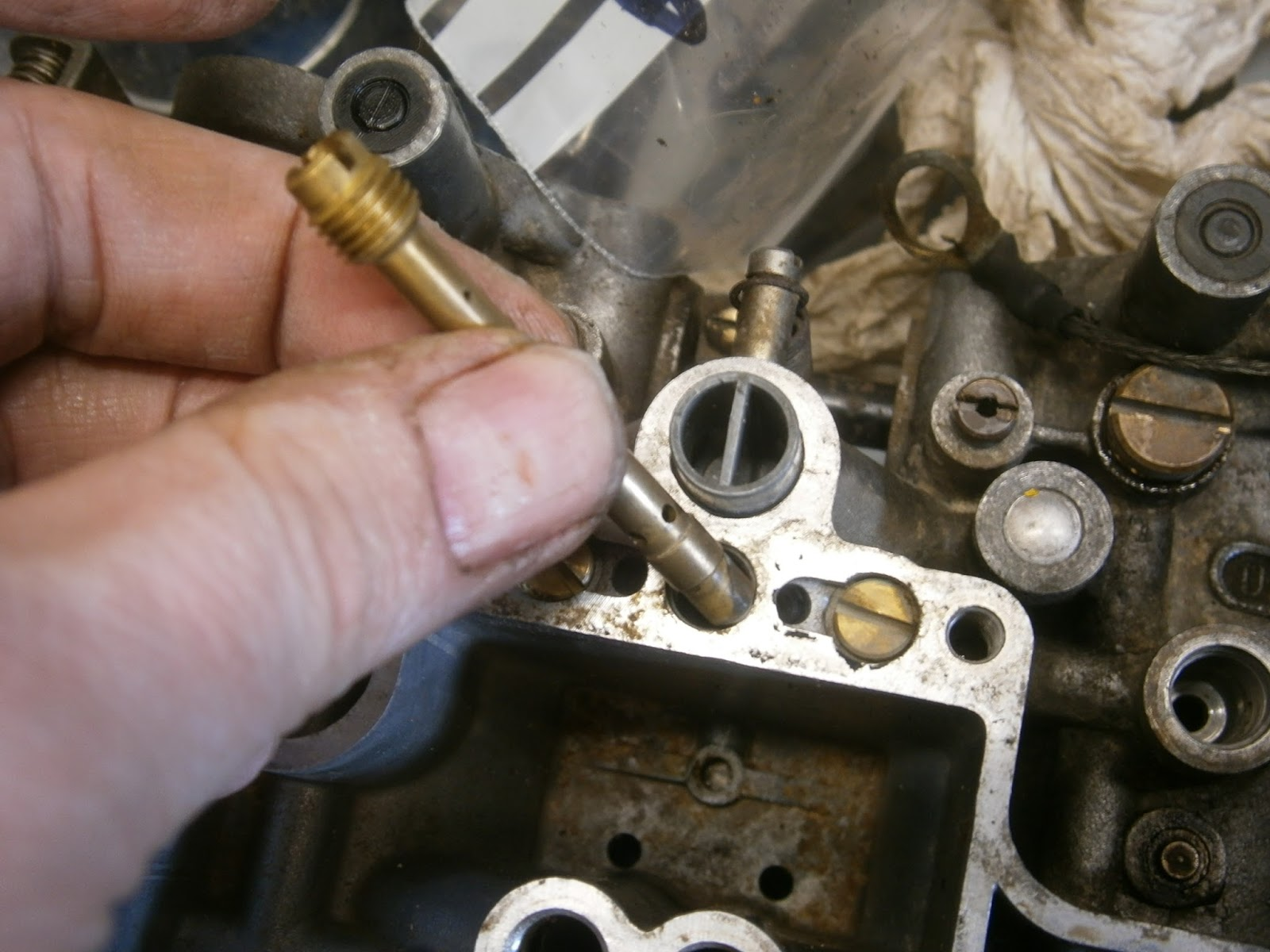 The choke emulsifier just unscrews and could be cleaned with the carb  cleaner