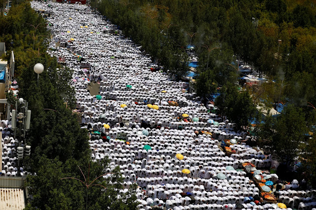 "uslim pilgrims in the Holy Land on Arafat Day  ""Reuters"""