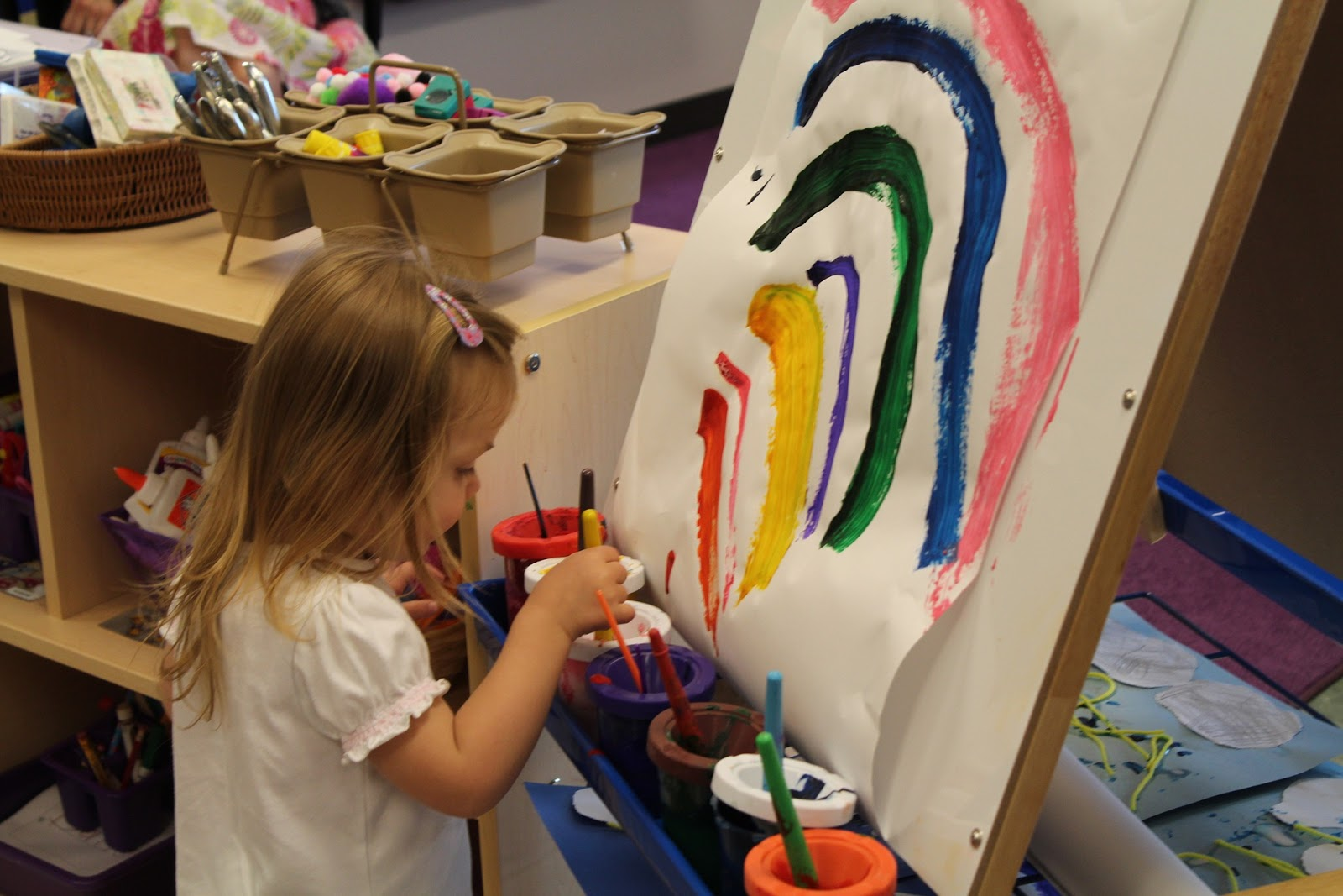 NAMC montessori freedom is not permissiveness. Young girl painting a rainbow