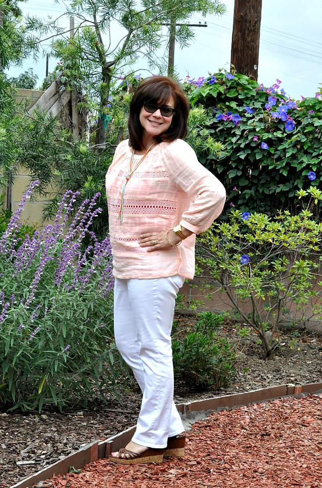 white jeans and peach blouse