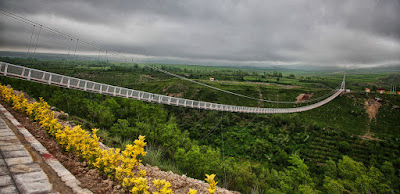 Meshgin shahr Suspension Bridge in Ardabil province, a record-breaking 365 meters long and two meters wide, is being constructed on the Khiavchai River