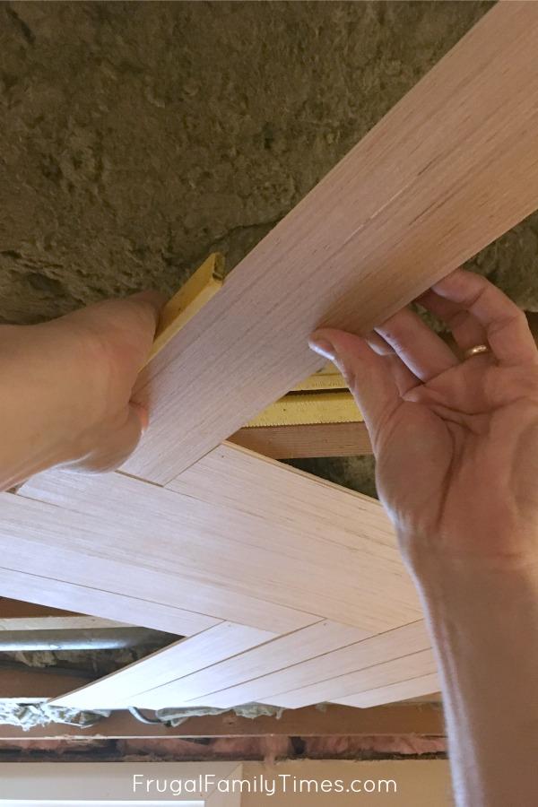 installing basement herringbone ceiling
